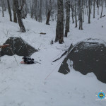 Camp. Low snow fell and skidded slightly our tents.